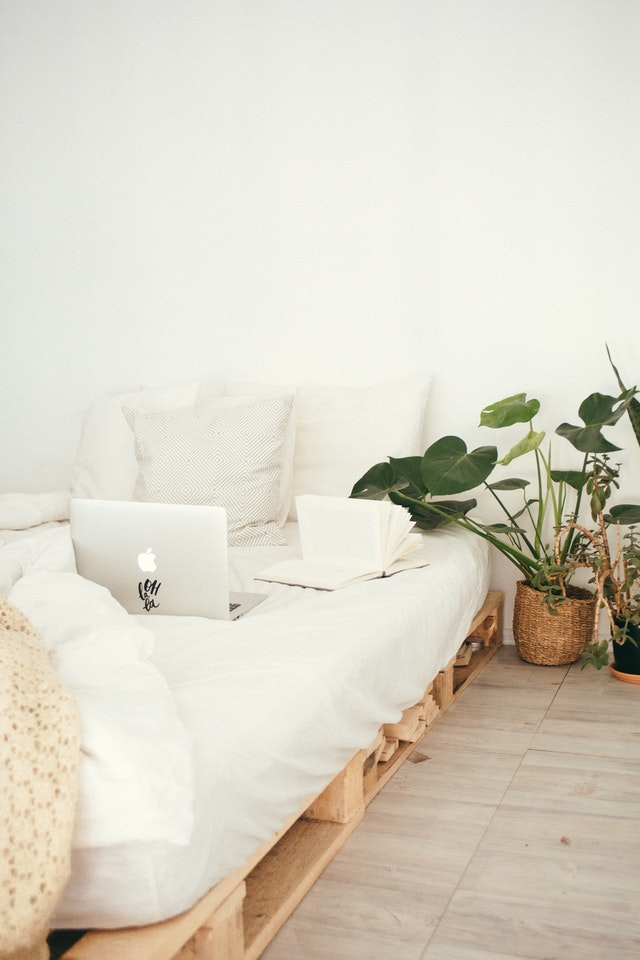A bedroom with white decor
